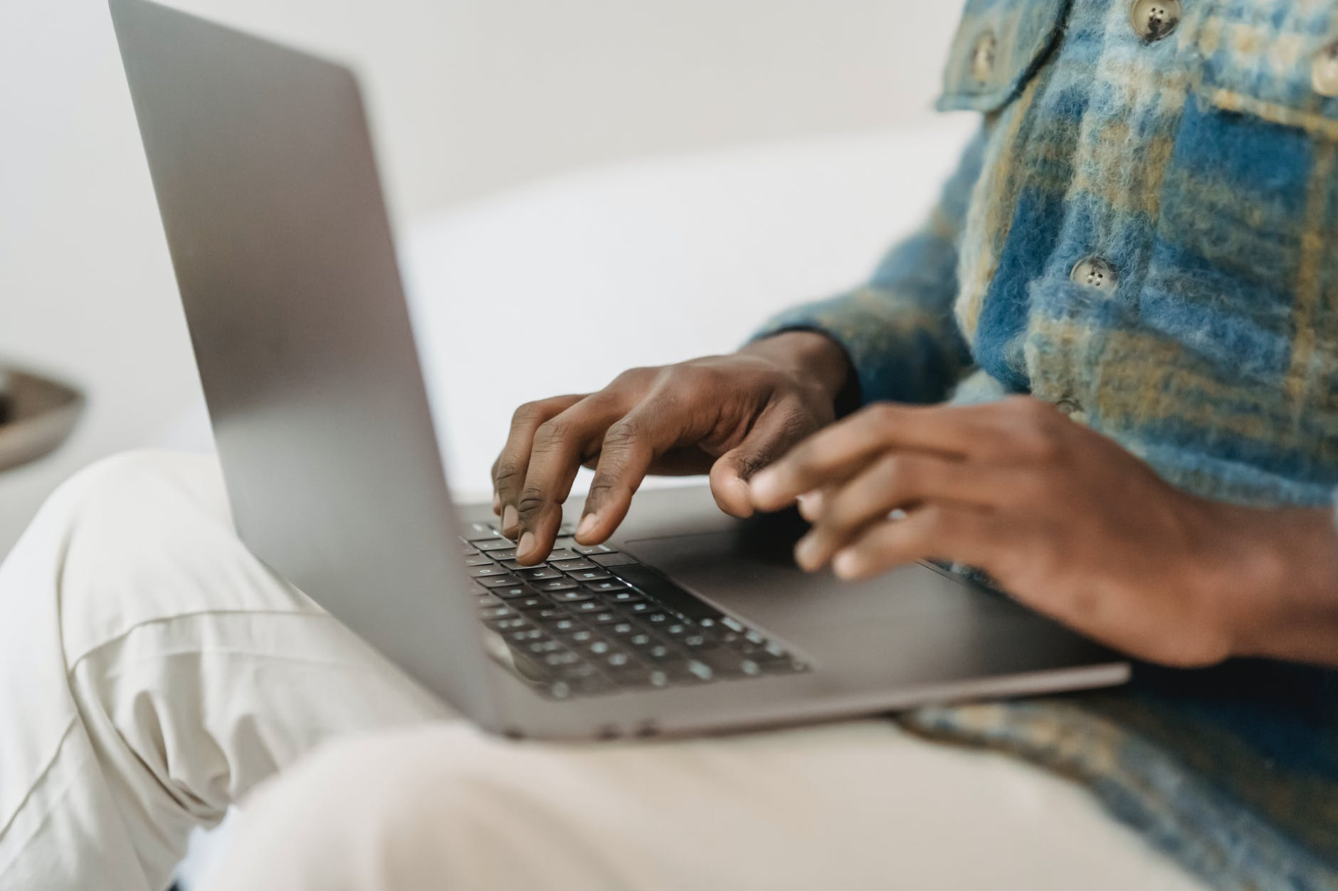 african american man in casual clothes using laptop